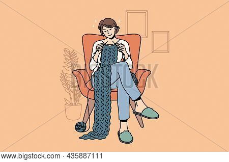 Knitting And Home Hobbies Concept. Young Smiling Woman Cartoon Character Sitting At Home In Armchair