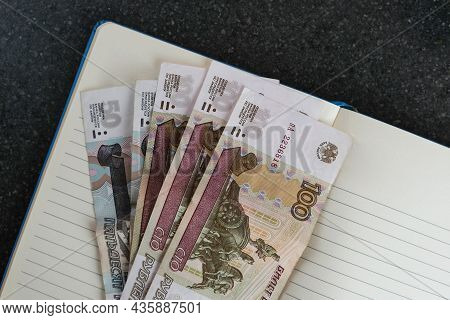 Russian Banknotes In Denominations Of 100 And 50 Rubles. Cash Of The Russian Federation For Payment