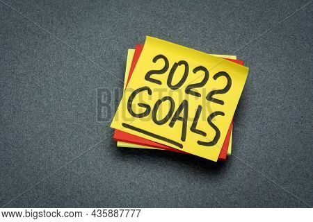 2022 goals reminder  - handwriting on a sticky note, New Year resolutions and goal setting concept