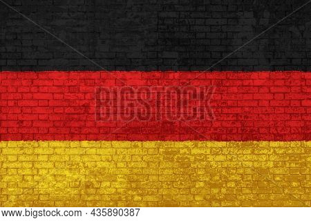 Wall Of Bricks Painted With The National Flag Of Germany. Black, Yellow And Red. 3d Background. Conc
