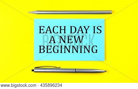 Text Each Day Is A New Beginning On The Blue Sticker On Yellow Background