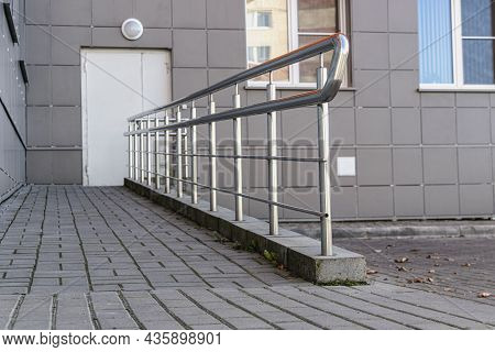 A Ramp And Metal Railing In The Hospital For The Reception Of Patients And For The Convenience Of Pe