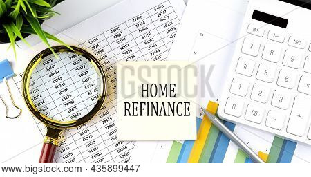 Home Refinance Text On Sticker On Diagram With Magnifier And Calculator. Business
