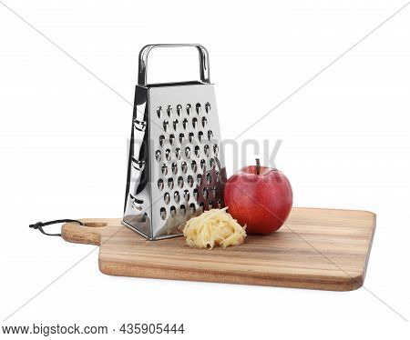 Stainless Steel Grater And Fresh Apple On White Background