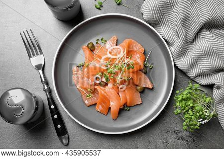 Salmon Carpaccio With Capers, Onion And Microgreens On Grey Table, Flat Lay