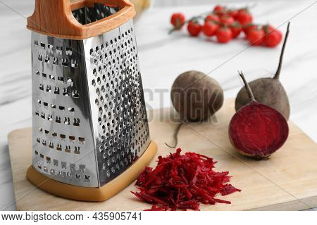 Grater And Fresh Ripe Beetroots On Wooden Board, Closeup