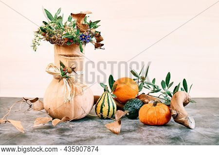 Festive Autumn Still Life With Smiling Pumpkin Which Has A Wreath Of Dried Flowers On It's Head. Fun