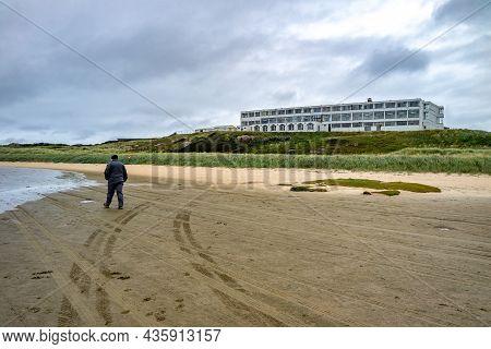 Man Walking At Bunbeg Beach , Bunbeg, Co. Donegal, Ireland