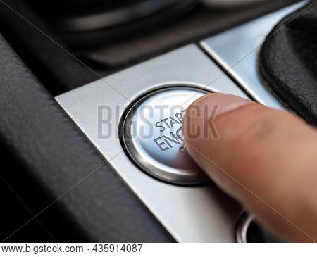 Man's Finger Presses Modern Car Button To Start Car, Macro.