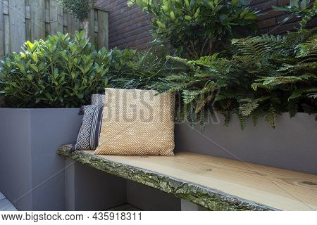 Cozy Seating, Wooden Sofa With Colorful Pillows In Cozy Garden Seat, Green Plants And Modern Decorat