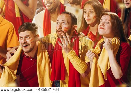 Spanish Emotive Football, Soccer Fans Cheering Their Team With A Red Scarfs At Stadium. Concept Of S