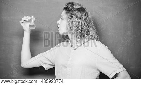 Chemistry Lab. Woman Teacher Performing Experiment With Bulb And Liquid. Interesting And Fascinating
