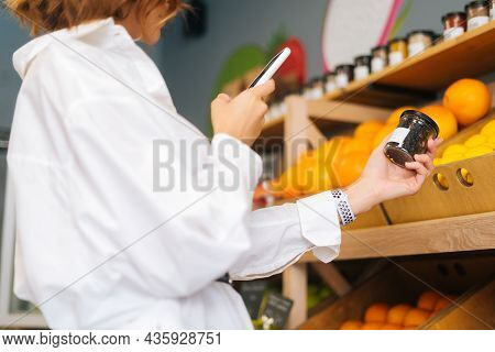 Close-up Cropped Shot Of Unrecognizable Young Woman Choosing Products In Market Walking Along Counte