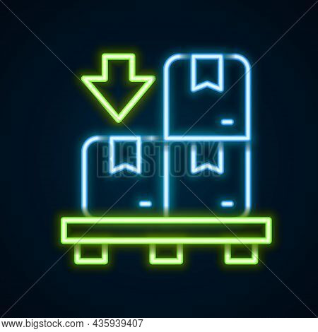 Glowing Neon Line Cardboard Boxes On Pallet Icon Isolated On Black Background. Closed Carton Deliver