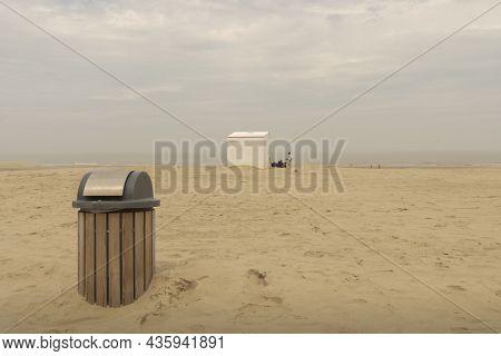 White Beach House And Trash Can On The North Sea Beach