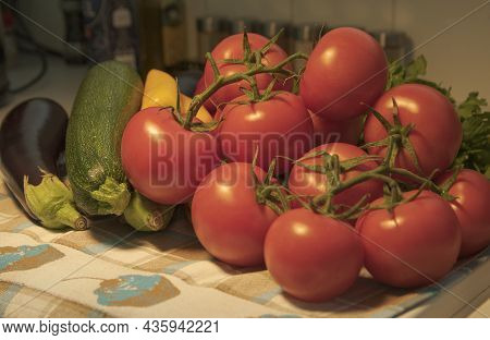 Tomatoes, Eggplant, Zucchini And Yellow Paprika On Table. Close-up.