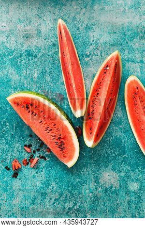 Slices  Of Juicy Watermelon On A Rustic Background. Top View, Blank Space