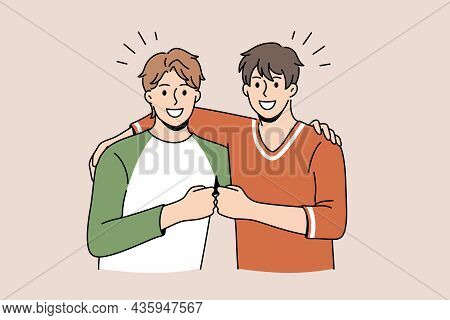 Friendship And Positive Emotions Concept. Two Young Smiling Happy Men Friends Standing Pulling Fists