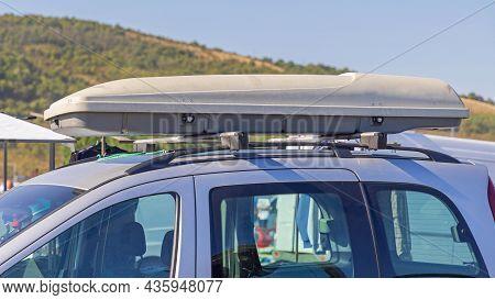 Long Aerodynamic Roof Box At Top Of Minivan