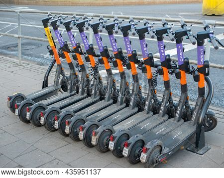 Moscow, Russia - October 5, 2021: Electric Scooters Stand In A Row On The Streets Of Moscow, Waiting
