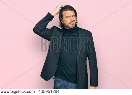 Middle age handsome man wearing business clothes confuse and wonder about question. uncertain with doubt, thinking with hand on head. pensive concept.