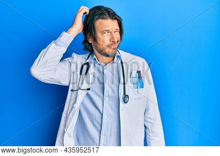 Middle age handsome man wearing doctor uniform and stethoscope confuse and wonder about question. uncertain with doubt, thinking with hand on head. pensive concept.