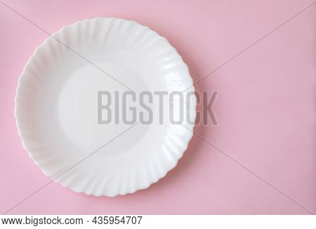 White  Dinner Plate With Soft Shadow On A Light Pink Surface Background. Ready To Drop Your Food