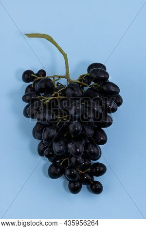 Fresh Ripe Grapes On A Blue Background.