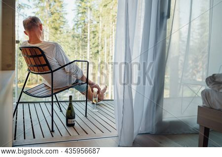 Alone Man Sitting On The Country House Balcony And Enjoying The Natural Forest View, Fresh Air And C