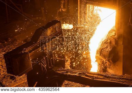 The Process Of Taking A Sample Of Liquid Metal In A Steelmaking Furnace