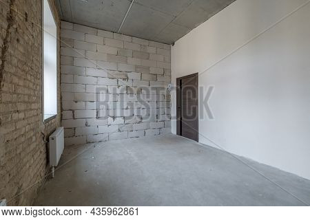 Empty White Room With Repair And Without Furniture. Room For Office Or Store
