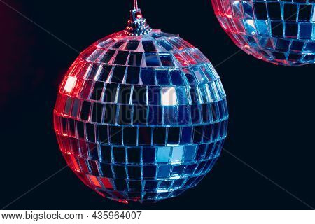 Sparkling Disco Balls Hanging In The Air Against Black Background