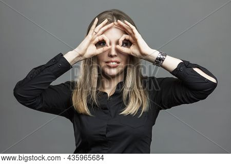 Young Woman Shows Ok Sign By Closing Her Eyes. Masonic Signs And Symbols, The Theory Of The World Co