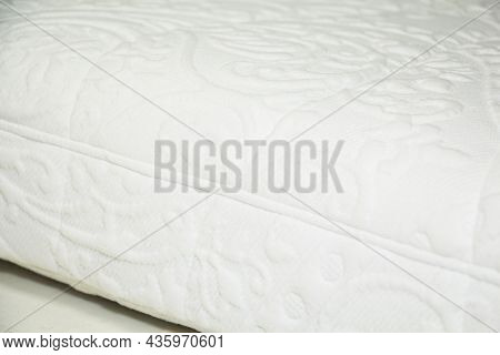 Close-up Of The Mattress Background, White Mattress Fabric With Patterns.