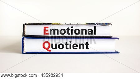 Eq Emotional Quotient Symbol. Concept Words 'eq Emotional Quotient' On Books On A Beautiful White Ta