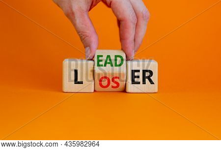 From Loser To Leader Symbol. Businessman Turns Wooden Cubes And Changes The Word 'loser' To 'leader'
