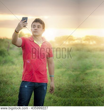 Young Man Taking A Picture, Young Man Taking Selfie In The Field, Young Man In The Field Taking A Pi