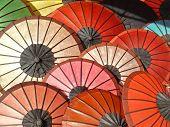 Colorful umbrellas in a market in Luang Prabang, Laos poster
