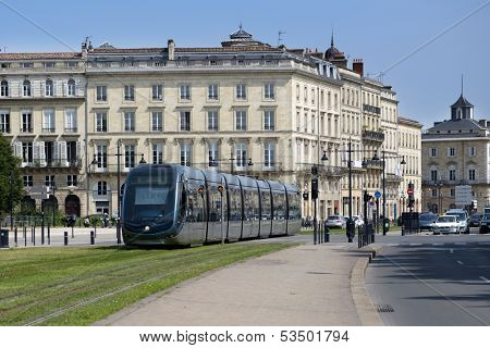 BORDEAUX, FRANCE - JUNE 27: Modern tram in the center of Bordeaux, France on June 27, 2013. The ground-level power supply was invented by APC company especially for the Bordeaux tramway system