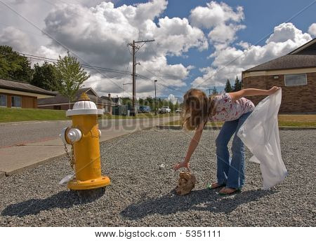 Girl Picking Up Garbage