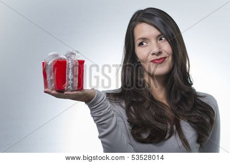 Woman Eyeing A Pretty Red Gift