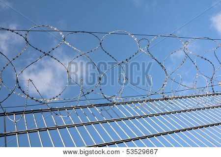 Barbed wire on top of a fence