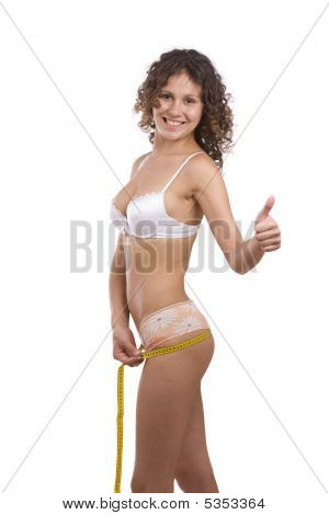 Smiling Fit Woman With Measure Tape Shows Ok