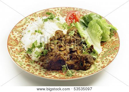 North Indian or Pakistani style bhuna gosht, a fairly dry lamb curry, served with rice and a salad