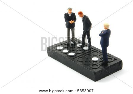 Business Man On Domino Isolated