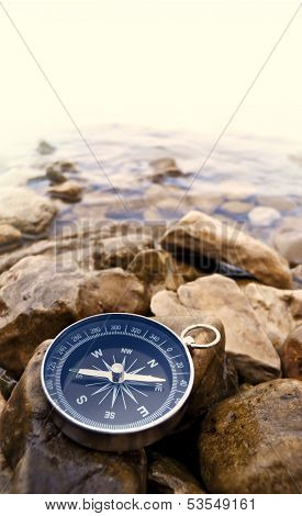 travel concept - compass on the bank