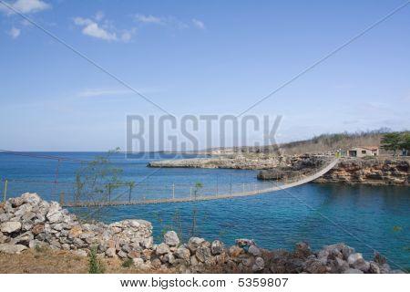 Wooden Bridge On A Rocky Seashore