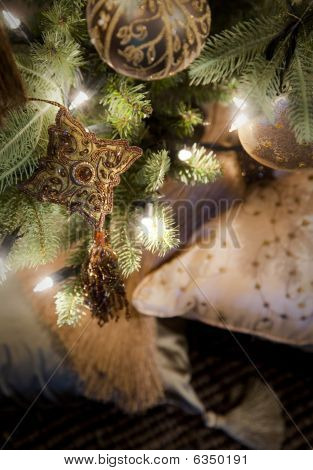 Golden Decorations Hanging On Christmas Tree