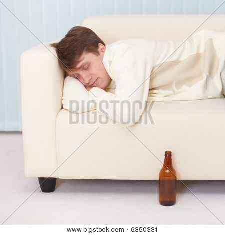 Person Comfortable Sleeps On Sofa Having Got Drunk Beer