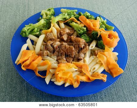 pork meat goulash with pasta and vegetables